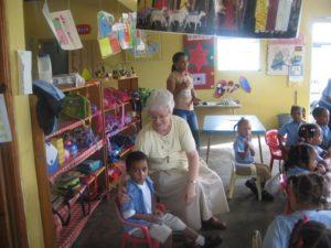 Sr. Barbara befriends a child in the Dominican Republic.
